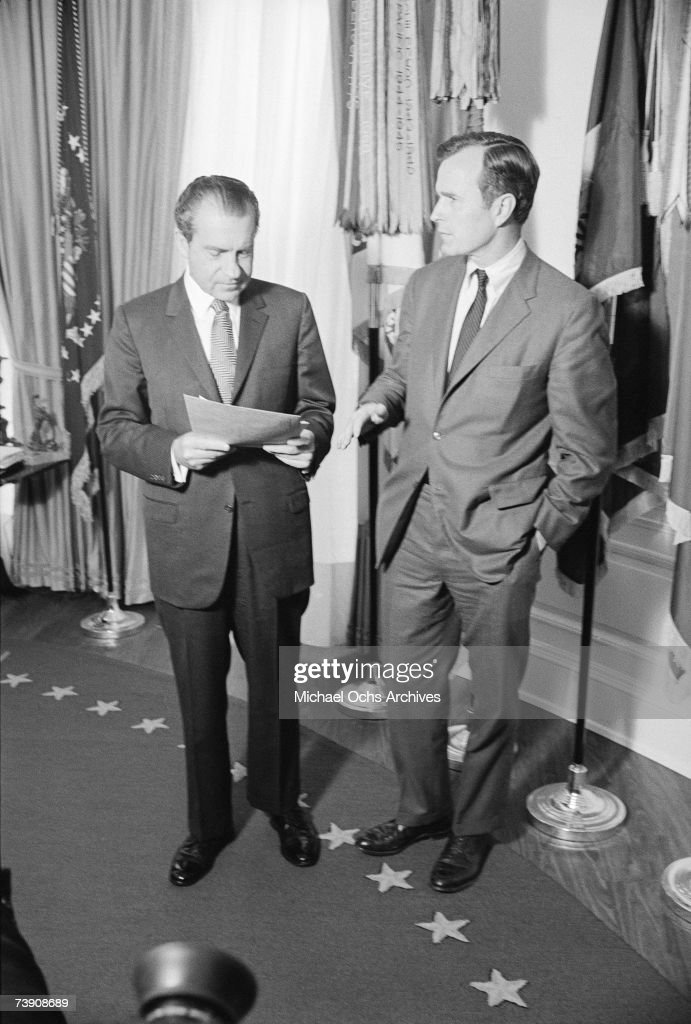 President Richard M. Nixon (L) and future President and current Congressman George H.W. Bush (R) discuss matters of state at the White House on January 12, 1970 in Washington DC.