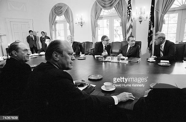 US President Richard M Nixon sits between Attorney General William B Saxbe and Secretary of State Henry Kissinger before conducting his final cabinet...