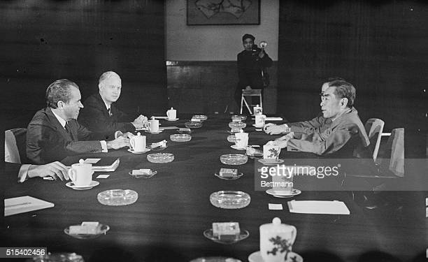 President Richard Nixon and John Holdridge staff member of the National Security Council sit across conference table from Chinese Premier Chou EnLai...