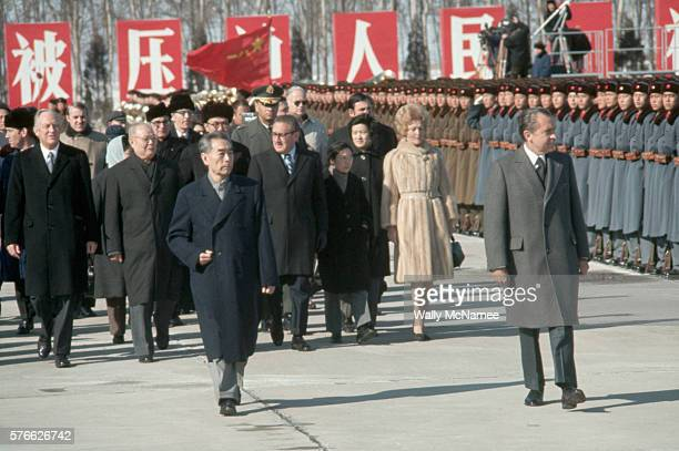 President Richard Nixon begins his 1972 trip to China by reviewing the People's Liberation Army honor guard at the Beijing Airport escorted by...