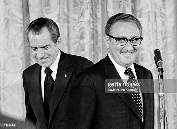 US President Richard Nixon congratulates newly appointed Secretary of State Henry Kissinger September 22 1973 in Washington DC Kissinger's oath as US...