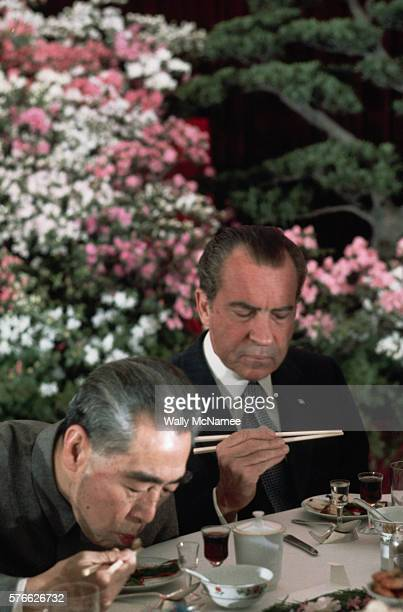 US President Richard Nixon considers the taste of a Chinese appetizer at an official banquet at the Great Hall of the People during Nixon's historic...