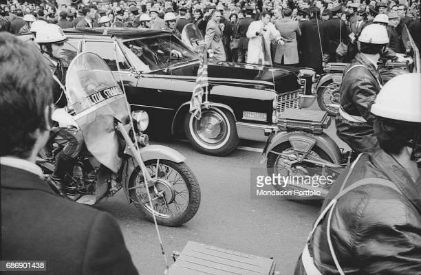 USA President Richard Nixon in a car escorted by policemen and Carabinieri riding moorbikes Rome February 1969