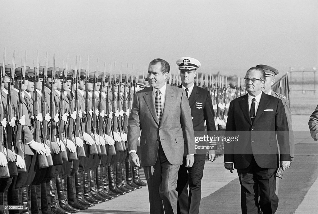 President <a gi-track='captionPersonalityLinkClicked' href=/galleries/search?phrase=Richard+Nixon&family=editorial&specificpeople=92456 ng-click='$event.stopPropagation()'>Richard Nixon</a> is escorted by Yugoslav President <a gi-track='captionPersonalityLinkClicked' href=/galleries/search?phrase=Josip+Broz+Tito&family=editorial&specificpeople=93742 ng-click='$event.stopPropagation()'>Josip Broz Tito</a> as Nixon reviews the honor guard upon arrival in Belgrade, September 30th.