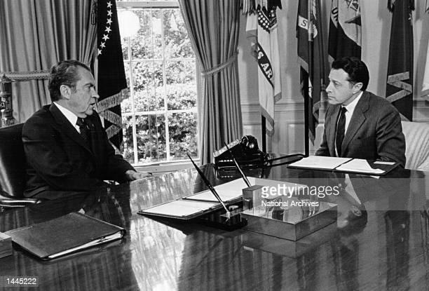 President Richard Nixon meets with Casper Wienburger May 13 1974 in the Oval Office in Washington DD