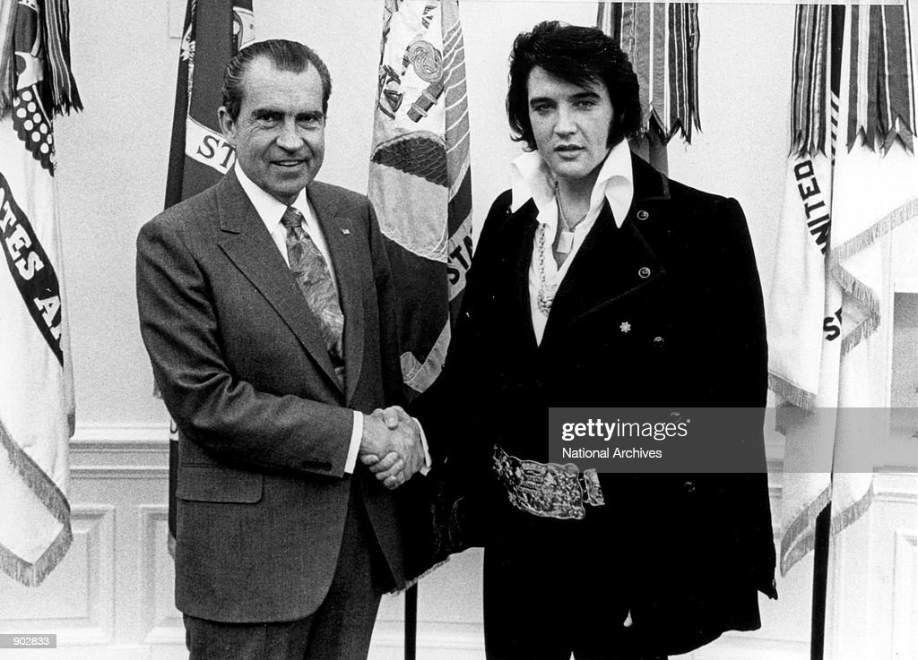President <a gi-track='captionPersonalityLinkClicked' href=/galleries/search?phrase=Richard+Nixon&family=editorial&specificpeople=92456 ng-click='$event.stopPropagation()'>Richard Nixon</a> meets with <a gi-track='captionPersonalityLinkClicked' href=/galleries/search?phrase=Elvis+Presley&family=editorial&specificpeople=67209 ng-click='$event.stopPropagation()'>Elvis Presley</a> December 21, 1970 at the White House.