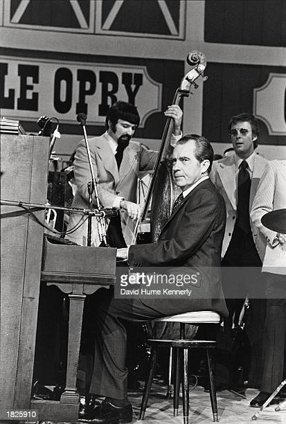 US President Richard Nixon plays the piano during the dedication of the Grand Ole Opry March 16 1974 in Nashville Tennessee