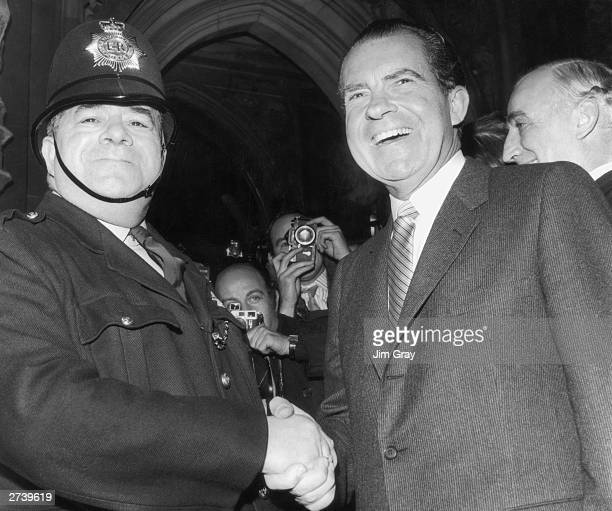 US President Richard Nixon shakes hands with PC Charles Cannon outside the House of Commons during a visit to London 25th February 1969