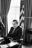 President Richard Nixon sits at his desk in the oval office of the White House September 16 1974