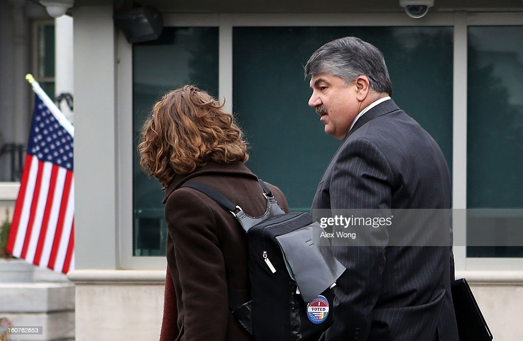 President <a gi-track='captionPersonalityLinkClicked' href=/galleries/search?phrase=Richard+Trumka&family=editorial&specificpeople=2701507 ng-click='$event.stopPropagation()'>Richard Trumka</a> (R) arrives at the White House for a meeting with U.S. President Barack Obama February 5, 2013 in Washington, DC. Obama was meeting with labor leaders to discuss issues including immigration reform, economy, and deficit reduction.