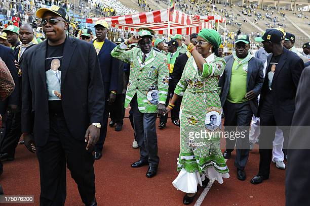 President Robert Mugabe and his wife Grace arrive at the ZANU PF rallyon July 28 2013 in Harare Zimbabwe The Zimbabwean President held his final...