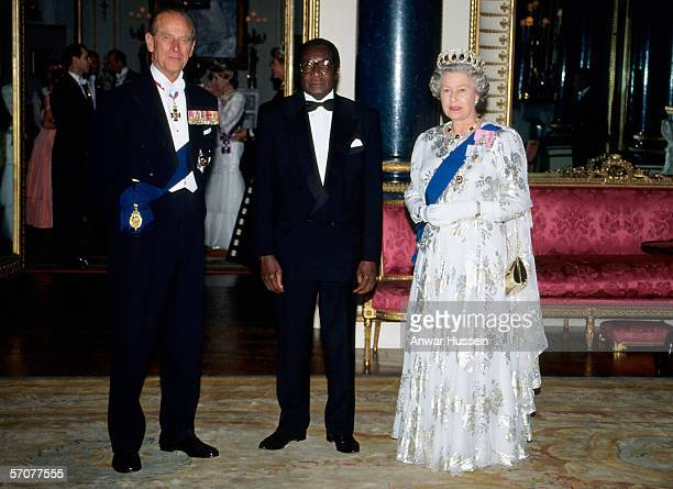 President Robert Mugabe of Zimbabwe is greeted by Queen Elizabeth ll and Prince Phillip the Duke of Edinburgh at Buckingham PalaceLondon during his...