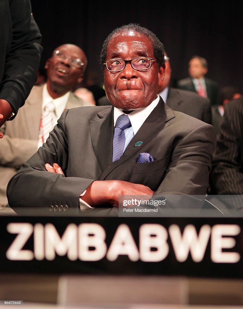 President Robert Mugabe of Zimbabwe looks up as he attends the opening ceremony of the High Level Segment of The United Nations Climate Change Conference on December 15, 2009 in Copenhagen, Denmark. Politicians and environmentalists are meeting for the United Nations Climate Change Conference 2009 that runs until December 18. Some of the participating nation's leaders will attend the last days of the summit.