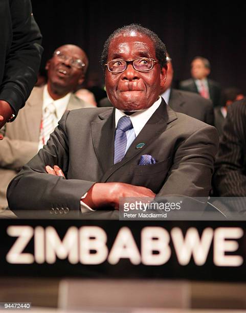 President Robert Mugabe of Zimbabwe looks up as he attends the opening ceremony of the High Level Segment of The United Nations Climate Change...