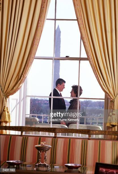 US President Ronald and wife Nancy Reagan stand on the Truman balcony of the White House in 1982 in Washington DC Born the son of a shoe salesman in...