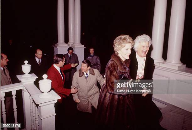 President Ronald Reagan and First Lady Nancy Reagan escorted by Vice President George HW Bush and Mrs Barbara Bush respectively as they arrive at the...