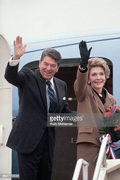 President Ronald Reagan and First Lady Nancy Reagan wave from the top of the steps of Air Force One on their way to Geneva and the summit meeting...