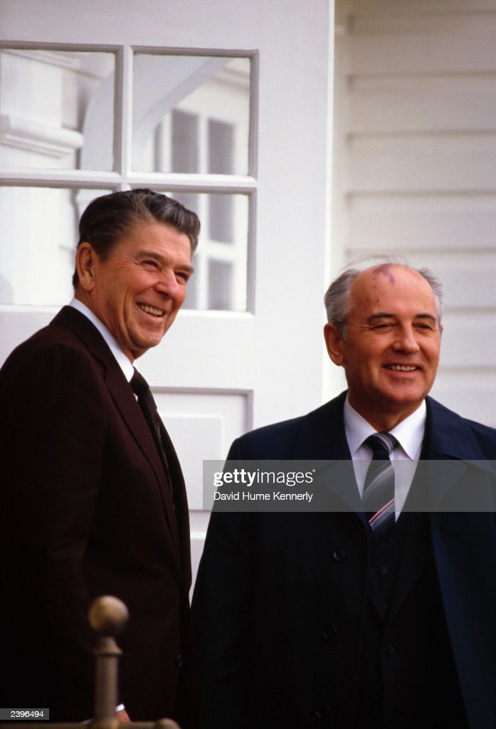 U.S. President Ronald Reagan and Soviet leader Mikhail S. Gorbachev stand in front of the Hofdi House during their second summit meeting October 1986 in Reykjavik, Iceland.