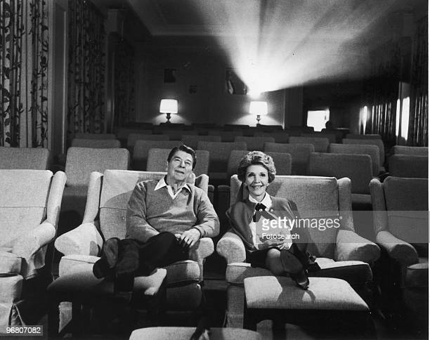 President Ronald Reagan and wife Nancy Reagan sitting in their screening room circa 1980s