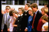 President Ronald Reagan and wife Nancy standing with wife of astronaut Michael Smith and other family members at memorial service for the victims of...