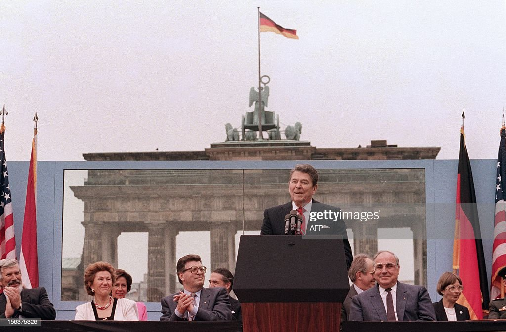 US President Ronald Reagan, commemorating the 750th anniversary of Berlin, addresses on June 12, 1987 the people of West Berlin at the base of the Brandenburg Gate, near the Berlin wall. Due to the amplification system being used, the President's words could also be heard on the Eastern (Communist-controlled) side of the wall. 'Tear down this wall!' was the famous command from United States President Ronald Reagan to Soviet leader Mikhail Gorbachev to destroy the Berlin Wall. The address Reagan delivered that day is considered by many to have affirmed the beginning of the end of the Cold War and the fall of communism. On Nov. 9-11, 1989, the people of a free Berlin tore down that wall. West German Chancellor Helmut Kohl is 2nd-right.