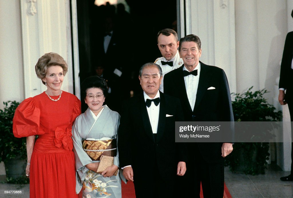 President Ronald Reagan First Lady Nancy Reagan and Japanese Prime Minister Zenko Suzuki and his wife pose for photographs at the North Portico...