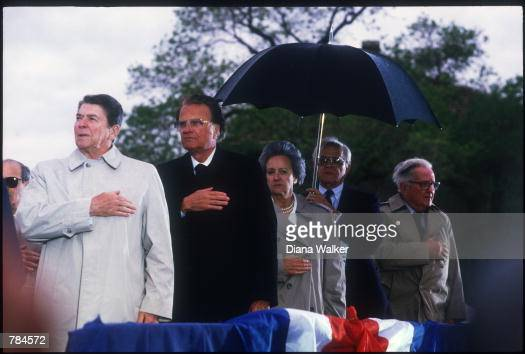 President Ronald Reagan puts his hand on his heart as he stands next to Reverend Billy Graham May 3 1987 at Ellis Island New York From 1892 to 1954...