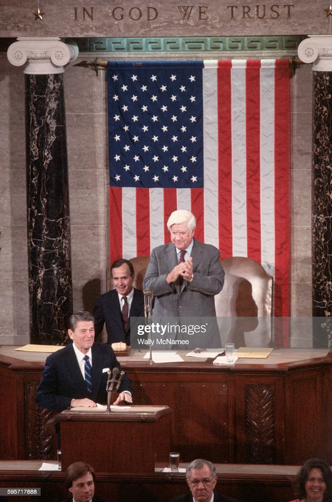 President Ronald Reagan responds to the cheers of the Joint Session of Congress prior to delivering his first speech to them since the March 1981...