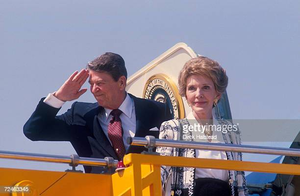 President Ronald Reagan salutes as he and wife Nancy Reagan depart on Air Force One June 1987
