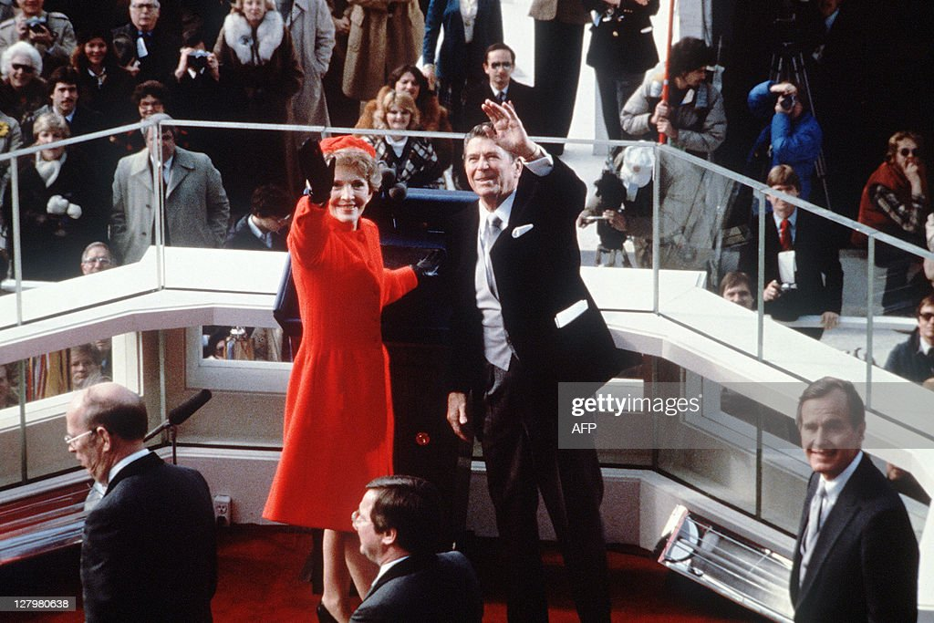 US President Ronald Reagan salutes beside his wife Nancy Reagan after being sworn in as 40th President of the United States by Chief Justice Warren...