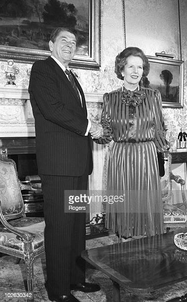 US President Ronald Reagan shakes hands with British Prime Minister Margaret Thatcher at 10 Downing Street London on June 05 1984