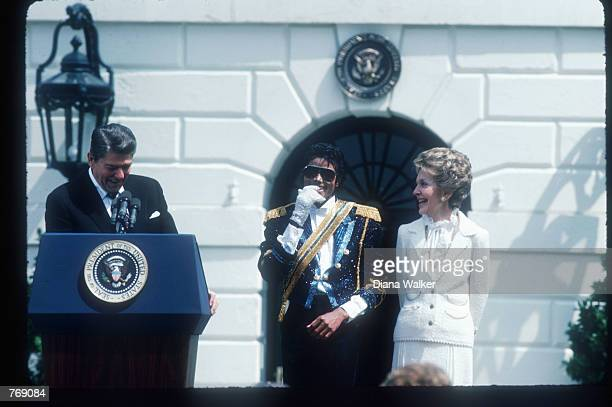 President Ronald Reagan speaks alongside wife Nancy and Michael Jackson May 4 1984 at the White House Jackson began singing professionally at the age...