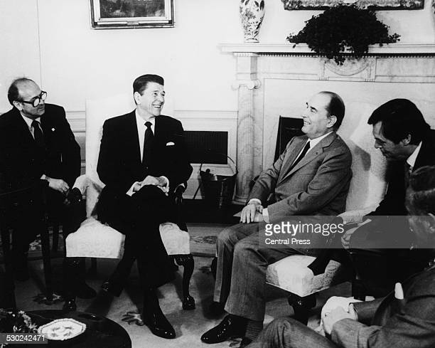 US President Ronald Reagan talking to French President Francois Mitterand in the Oval Office of the White House Washinton D C March 18th 1982