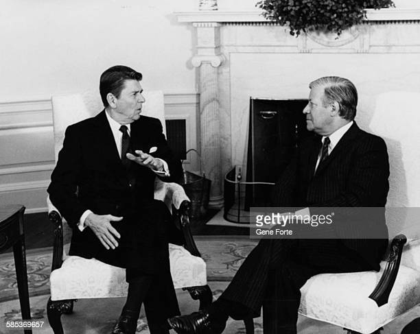 President Ronald Reagan talking to German Chancellor Helmut Schmidt at a meeting in the Oval Office of the White House Washington DC January 5th 1982