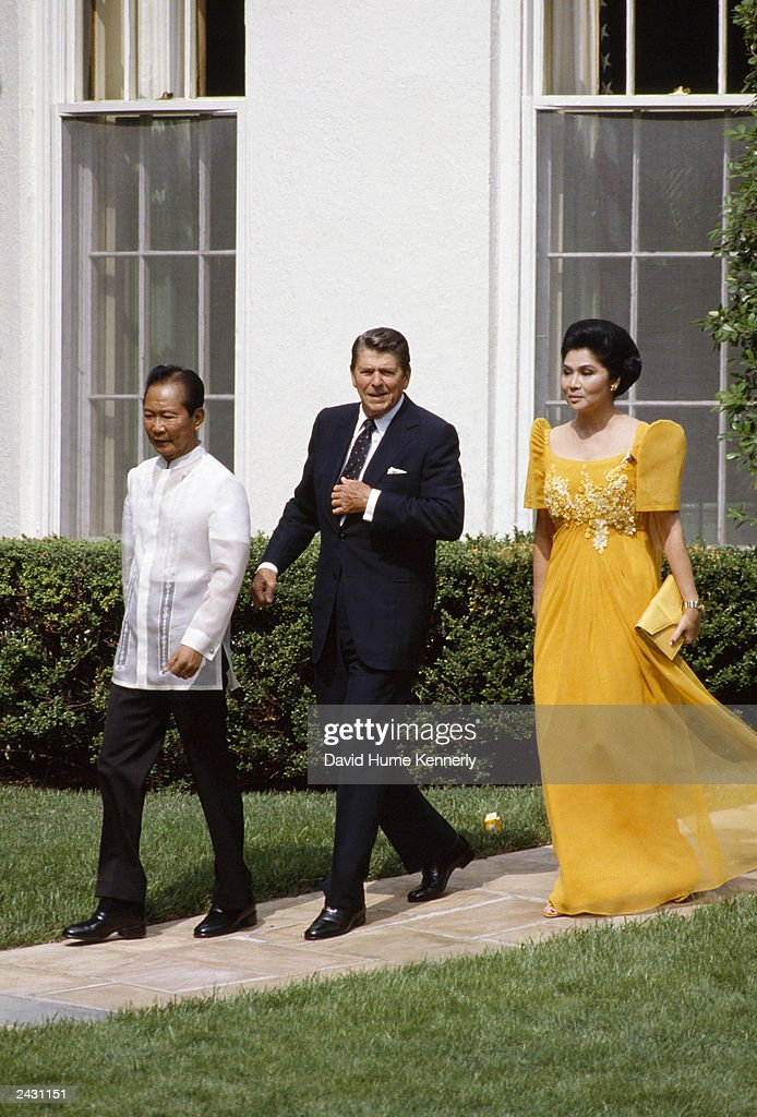 U.S. President Ronald Reagan walks with Philippine President Ferdinand Marcos (L) and First Lady Imelda Romualdez Marcos (r) after a visit to the Oval Office in the White House September 1982 in Washington, DC.
