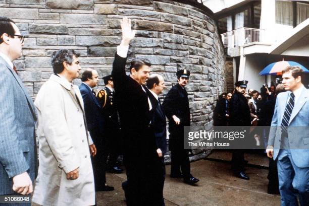 President Ronald Reagan Waves To Onlookers Moments Before An Assassination Attempt By John Hinckley Jr March 30 1981 By The Washington Hilton In...