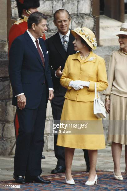 US President Ronald Reagan with his wife Nancy Reagan Queen Elizabeth II and Prince Philip during the ceremony in the Quadrangle at Windsor Castle to...