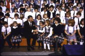President Ronald Reagan with kids at St Agatha's High School in Wayne County