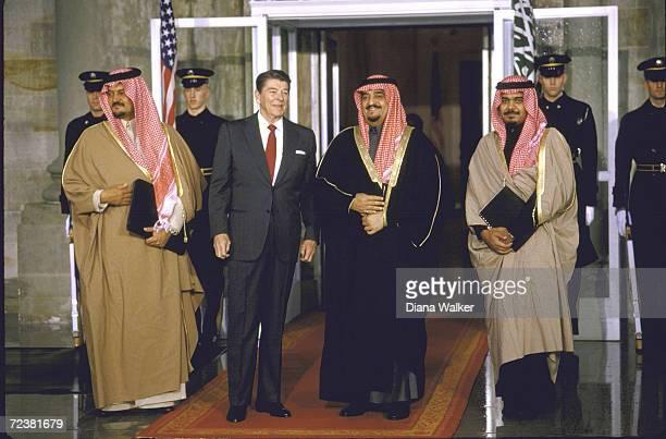 President Ronald Reagan with Saudi King Fahd Princes Bander Saud at WH portico