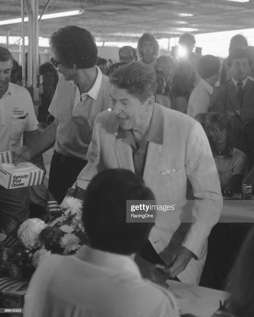S President Ronald Reagan works the crowd at the picnic lunch following the 1984 Firecracker 400 on July 4 1984 at the Daytona International Speedway...