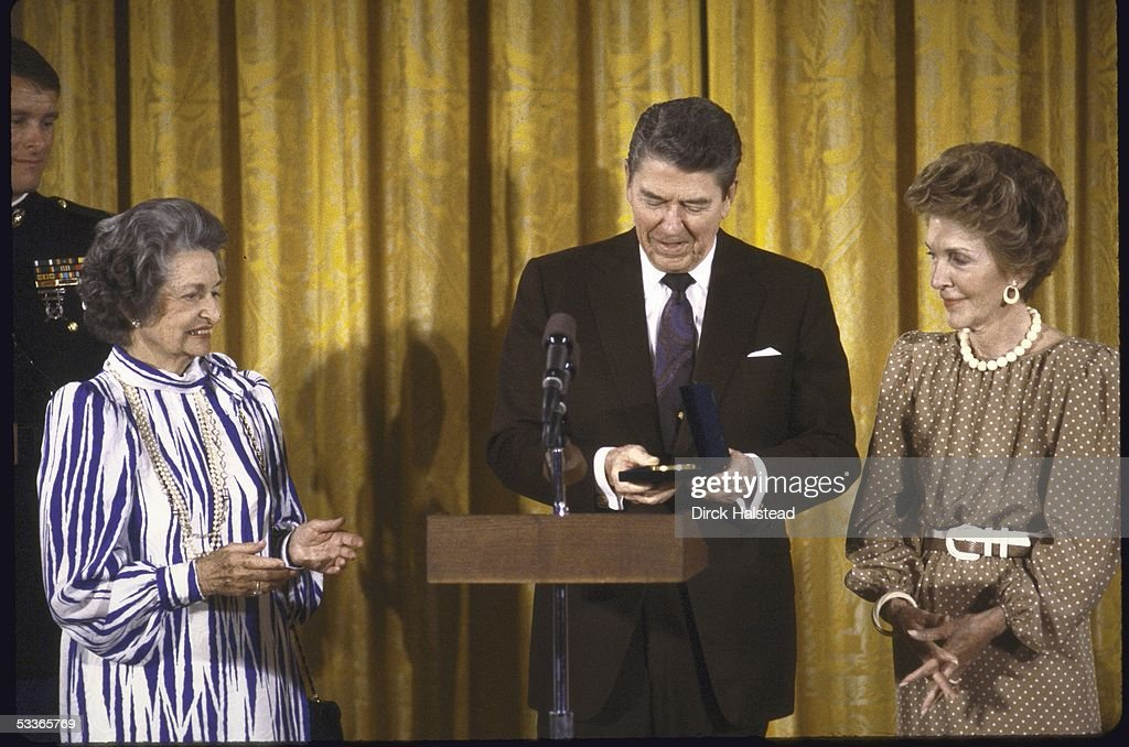 President Ronald with Reagan presenting Congressional Gold Medal to Mrs Lyndon B Johnson as Nancy Reagan looks on