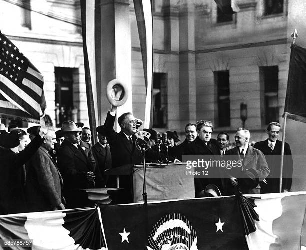 President Roosevelt delivering a speech in front of the crowd at Harisburg He is accompanied by John Lewis United States