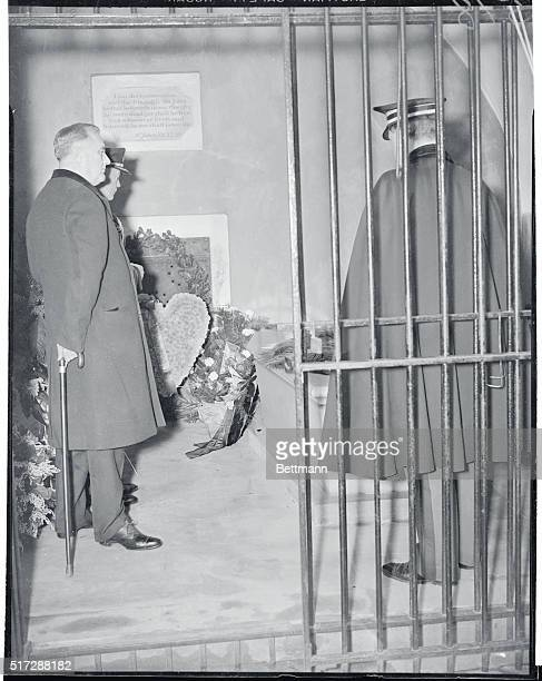 President Roosevelt stands erect after placing a wreath on the tomb of George Washington at Mount Vernon VA on the first President's birthday...
