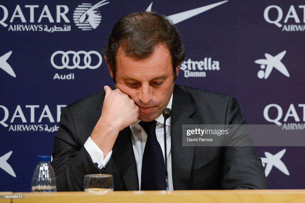 President <a gi-track='captionPersonalityLinkClicked' href=/galleries/search?phrase=Sandro+Rosell&family=editorial&specificpeople=2363208 ng-click='$event.stopPropagation()'>Sandro Rosell</a> looks down during the press conference announcing his resgination as FCB president on January 23, 2014 in Barcelona, Spain. FCB President <a gi-track='captionPersonalityLinkClicked' href=/galleries/search?phrase=Sandro+Rosell&family=editorial&specificpeople=2363208 ng-click='$event.stopPropagation()'>Sandro Rosell</a> is under investigation by a Spanish high court for the alleged misappropriation of funds from the transfer of Neymar Jr. FCB Vice-President Josep Maria Bartomeu will replace <a gi-track='captionPersonalityLinkClicked' href=/galleries/search?phrase=Sandro+Rosell&family=editorial&specificpeople=2363208 ng-click='$event.stopPropagation()'>Sandro Rosell</a> as new FCB president.