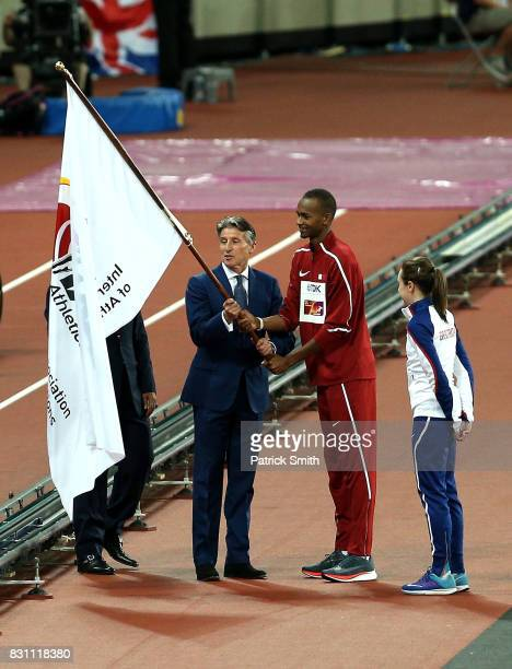 President Sebastian Coe Mutaz Essa Barshim of Qatar and Laura Muir of Great Britain participate in the handover ceremony during day ten of the 16th...