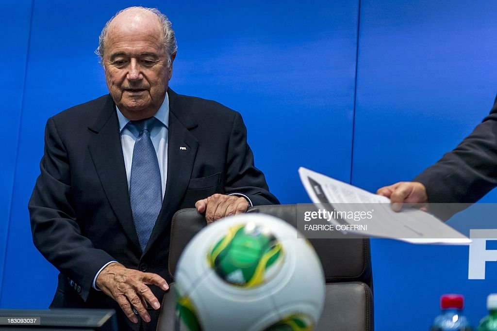 President Sepp Blatter arrives at a press conference on October 4, 2013 at FIFA headquarters in Zurich. FIFA said they could not get involved in labor issues in any country, amid calls for action after claims that dozens of migrant workers had died on construction projects linked to the 2022 World Cup in Qatar. Blatter, however said that the federation could not turn a blind eye to the reports, which also alleged that thousands of other workers endured conditions akin to 'modern-day slavery' in Qatar.
