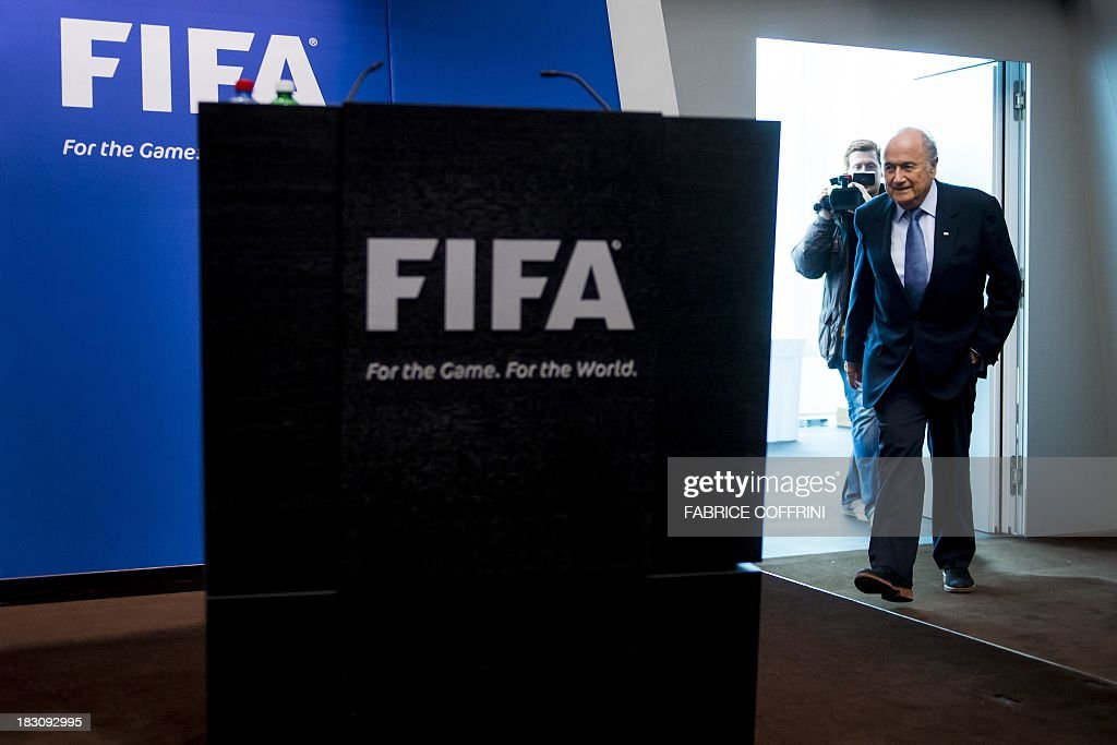 President Sepp Blatter arrives for a press conference on October 4, 2013 at the FIFA headquarters in Zurich. FIFA said they could not get involved in labour issues in any country, amid calls for action after claims that dozens of migrant workers had died on construction projects linked to the 2022 World Cup in Qatar. Blatter, however said that the federation could not turn a blind eye to the reports, which also alleged that thousands of other workers endured conditions akin to 'modern-day slavery' in Qatar.