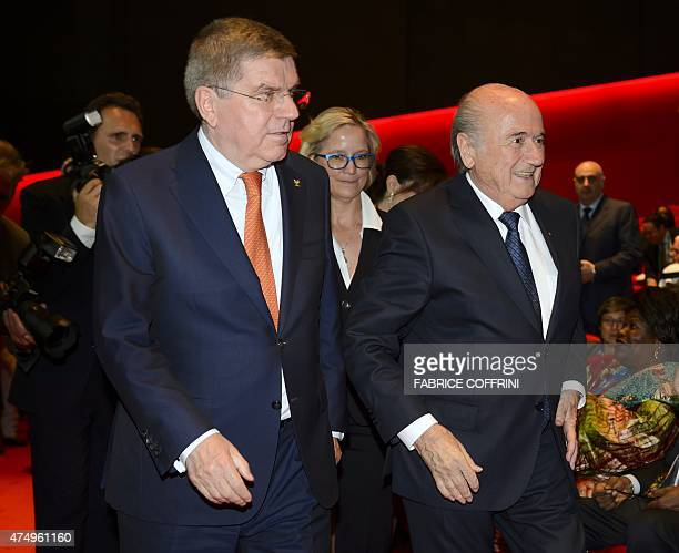 President Sepp Blatter arrives with International Olympic Committee President Thomas Bach for the opening ceremony of the 65th FIFA Congress in...