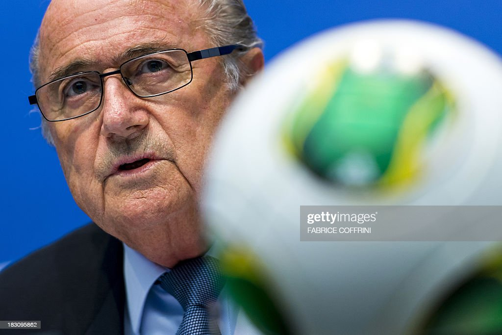 President Sepp Blatter attends a press conference on October 4, 2013 at the FIFA headquarters in Zurich. FIFA said they could not get involved in labour issues in any country, amid calls for action after claims that dozens of migrant workers had died on construction projects linked to the 2022 World Cup in Qatar. Blatter, however said that the federation could not turn a blind eye to the reports, which also alleged that thousands of other workers endured conditions akin to 'modern-day slavery' in Qatar.