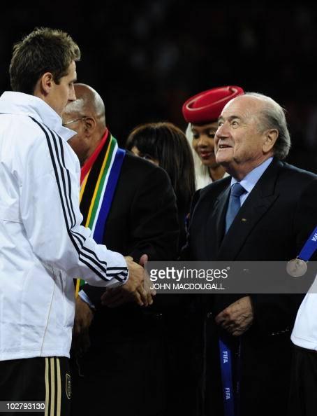 President Sepp Blatter congratulates Germany's striker Miroslav Klose after the 2010 World Cup third place match Uruguay vs Germany on July 10 2010...